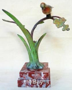 Bronze animalier Art Déco J. BRAULT. Un oiseau sur une branche fleurie