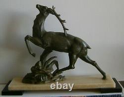 Sculpture animalière Art déco 1930 Cerf en régule patine vert bronze antique