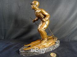 Sculpture régule patine bronze skieur art déco signé L. BRUNSWICK la descente